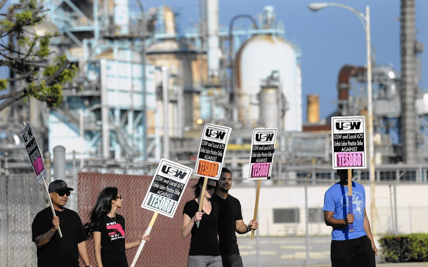 At L A  oil refinery, striking workers vent about long hours