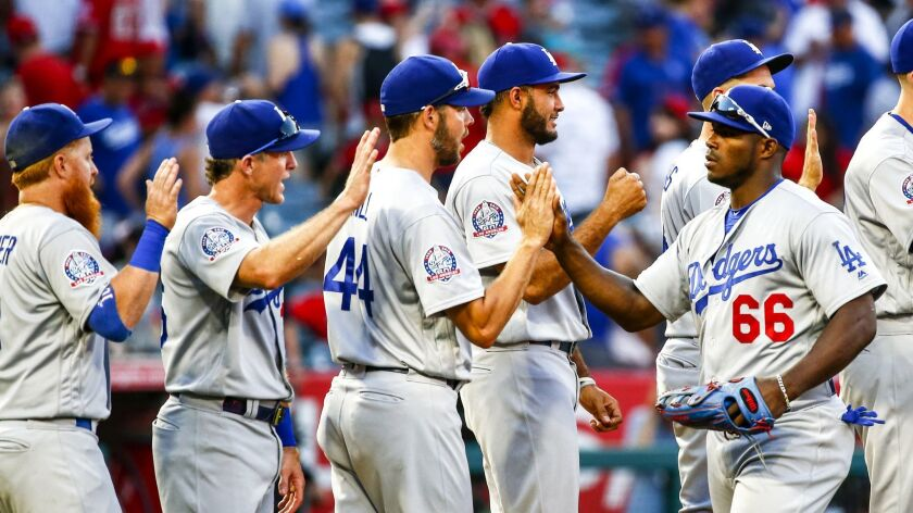 ANAHEIM, CALIF. - JULY 07: Los Angeles Dodgers right fielder Yasiel Puig (66) and his teammates cele