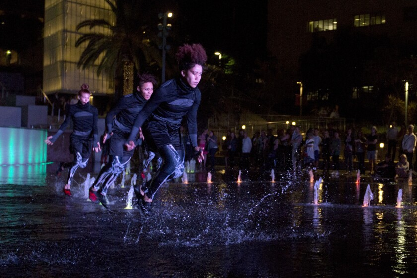 """Decadancetheatre dancers perform """"The Firebird"""" in the fountain in Grand Park."""