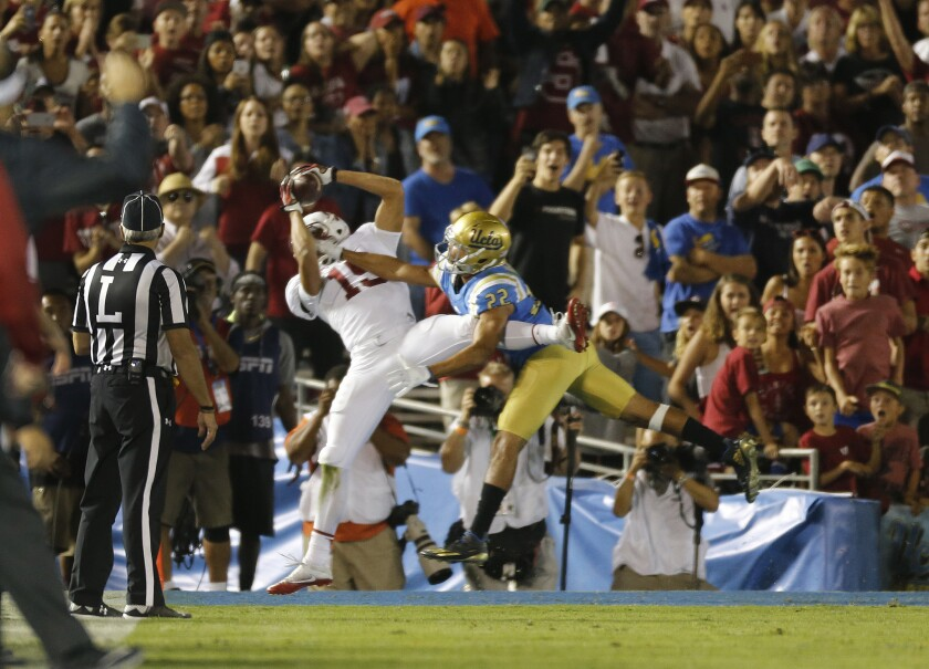 Stanford receiver JJ Arcega-Whiteside (19) catches the game-winning touchdown against UCLA defensive back Nate Meadors (22) during a game at the Rose Bowl on Sept. 24.