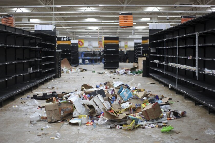Supermarket displays stand empty after looting Jan. 7 that followed a 20% hike in gasoline prices in Veracruz, Mexico.