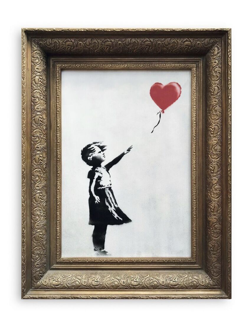 In this undated photo provided by Sotheby's the spray-painted canvas 'Girl with Balloon' by artist B