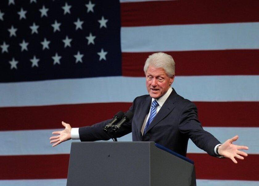 Bill Clinton backs extending Bush tax cuts, for now