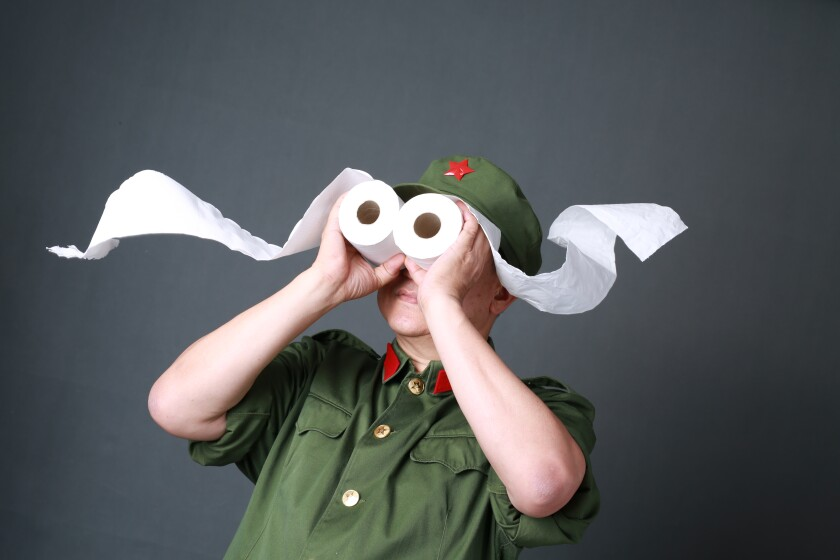 Jack Sim, subject of the documentary 'Mr. Toilet: The World's #2 Man,' uses two rolls of toilet paper as binoculars