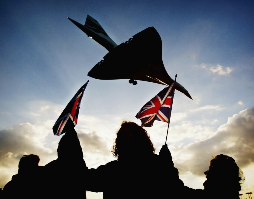 Spectators watch the last ever British Airways commercial Concorde flight touch down at Heathrow Airport on October 24, 2003 in London. Boeing said it hopes to develop a supersonic plane that will cross the Atlantic in two hours — faster than the legendary Concorde.