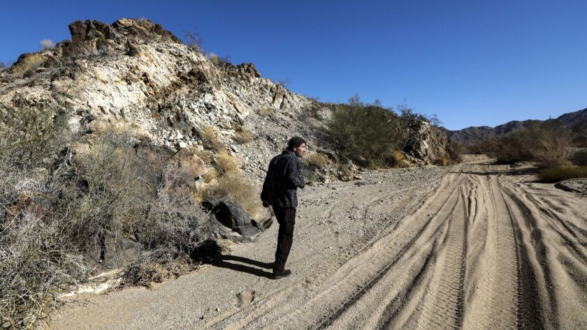 Tom Egan, California desert representative for the nonprofit Defenders of Wildlife, walks along a wash marked by off-road vehicle activities at Chuckwalla Bench.