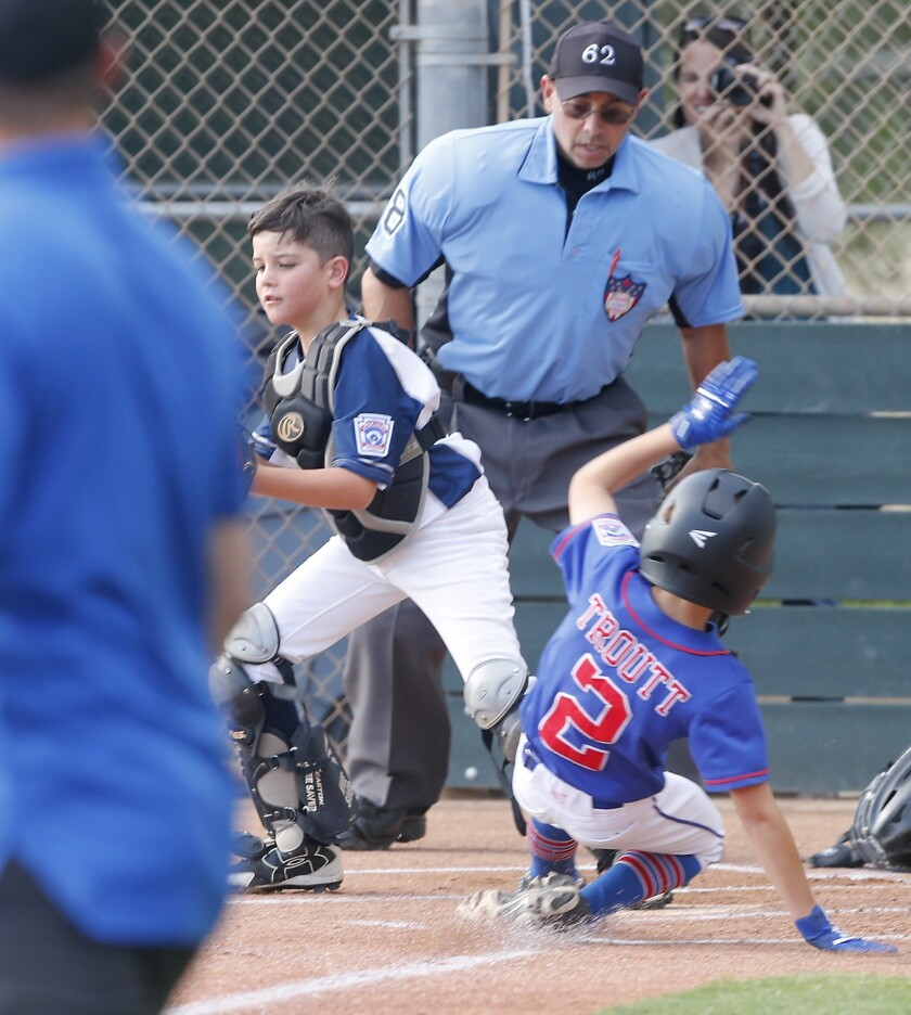 Seaview Little League No. 2 team catcher Carson Cato, left, gets the force out at home plate against