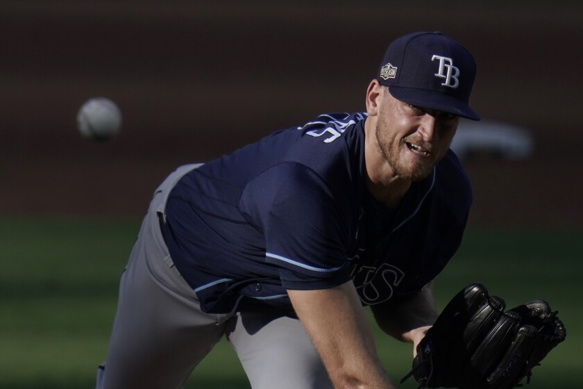 Tampa Bay Rays pitcher Aaron Slegers throws during the during the fifth inning against the Houston Astros in Game 5 of a baseball American League Championship Series, Thursday, Oct. 15, 2020, in San Diego. (AP Photo/Gregory Bull)