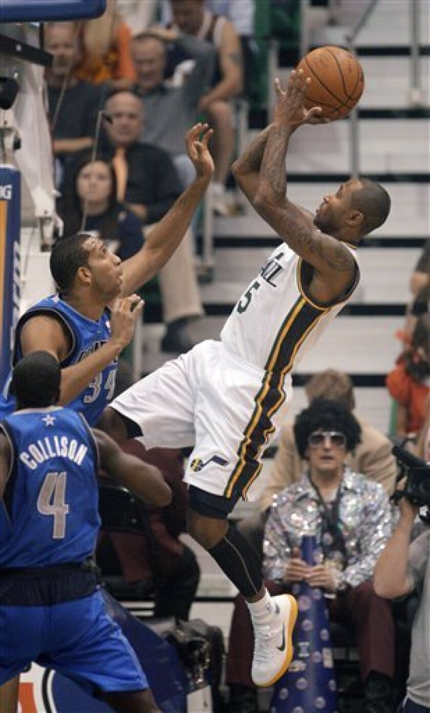 Utah Jazz guard Mo Williams (5) shoots as Dallas Mavericks forward Brandan Wright (34) defends in the first quarter during an NBA basketball game Wednesday, Oct. 31, 2012, in Salt Lake City. (AP Photo/Rick Bowmer)