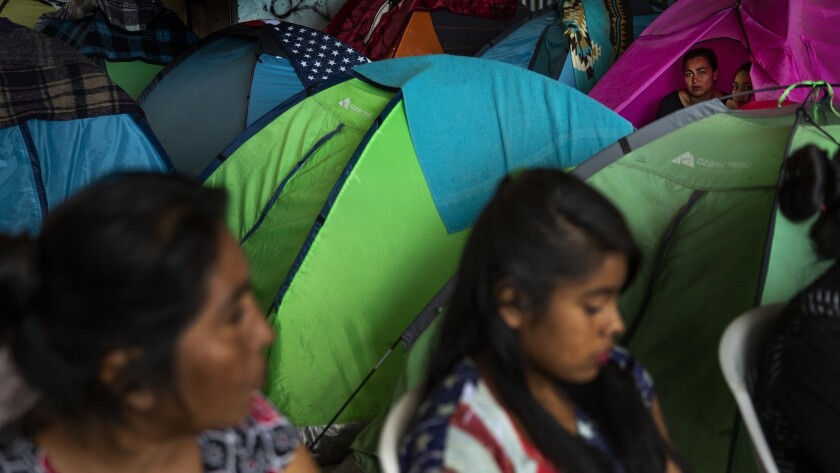 TIJUANA, MEXICO - JUNE 19, 2018: Women and children fleeing the drug cartel violence from Michoacan