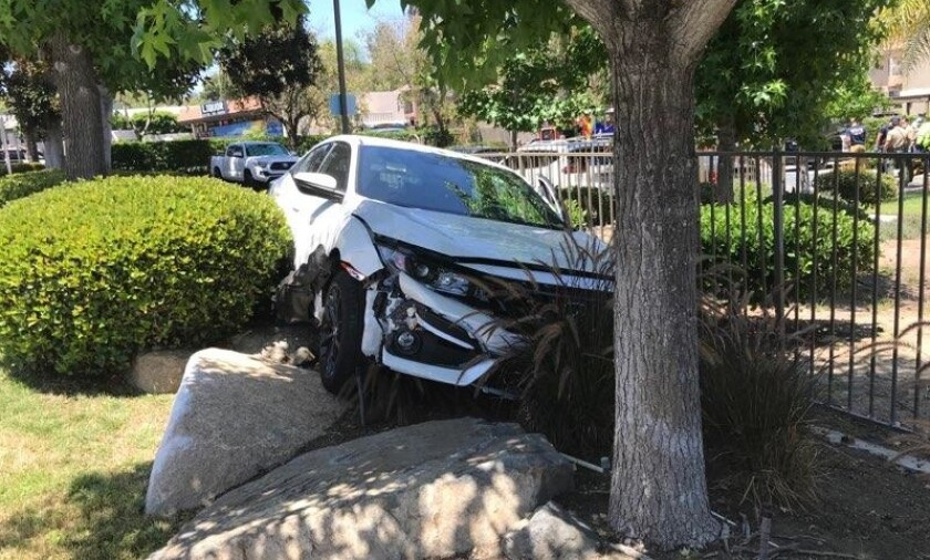 A man suspected of carjacking a woman Friday in Santee later crashed the stolen car while fleeing from authorities in La Mesa