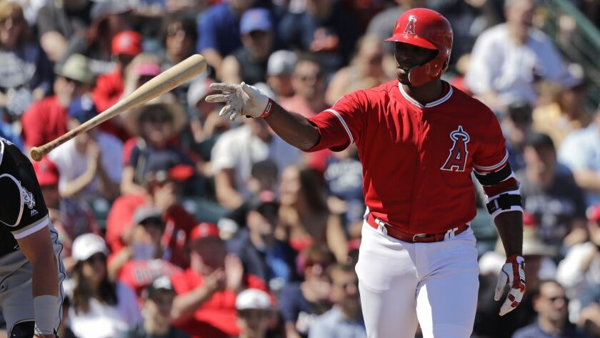 The Angels' Justin Upton tosses aside his bat after walking against the Chicago White Sox in a spring training game on March 22 in Tempe, Ariz.