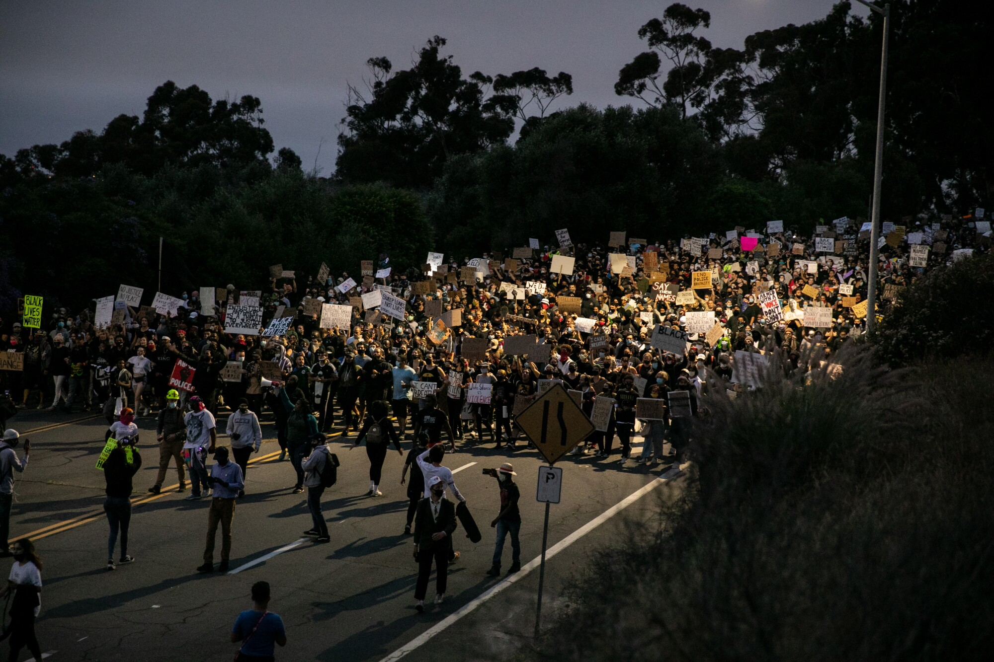 Thousands of protestors demanding racial justice in the U.S march down Pershing Drive toward downtown San Diego on June 4.