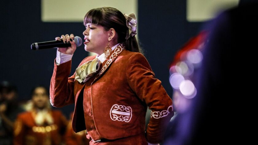 Josie Borges doesn't speak Spanish, but her father translates the mariachi lyrics to help her understand their meaning.
