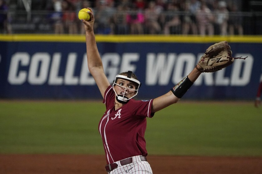 Alabama's Montana Fouts pitches in the first inning of the team's NCAA Women's College World Series softball game against UCLA, Friday, June 4, 2021, in Oklahoma City. (AP Photo/Sue Ogrocki)