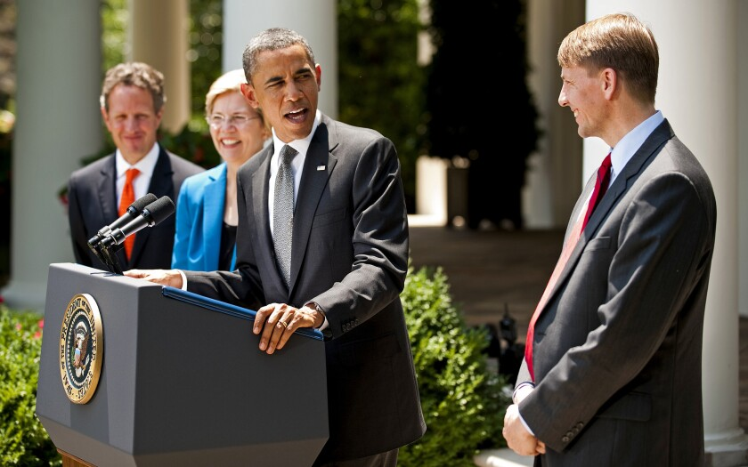 President Obama nominates Richard Cordray, right, to lead the Consumer Financial Protection Bureau in 2011. Watching are Sen. Elizabeth Warren (D-Mass.), then a special advisor to Obama, and former Treasury Secretary Timothy F. Geithner.