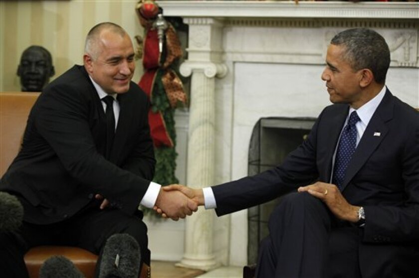 President Barack Obama shakes hands with Bulgarian Prime Minister Boyko Borisov during their meeting in the Oval Office of the White House in Washington, Monday, Dec. 3, 2012. The two leaders will discuss Bulgaria's role in NATO and its contributions to NATO-led efforts in Afghanistan. They'll also discuss ongoing legal reforms in Bulgaria. (AP Photo/Charles Dharapak)