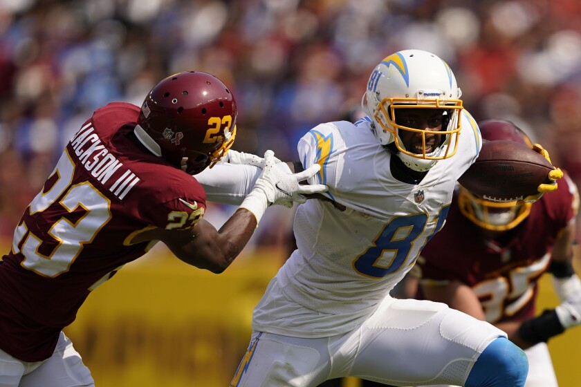 Chargers receiver Mike Williams breaks away from Washington Football Team cornerback William Jackson.
