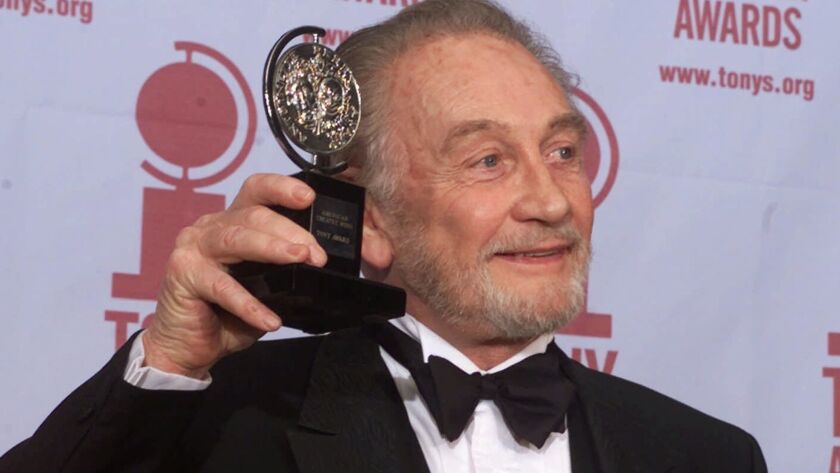 FILE - In this file photo dated Sunday, June 4, 2000, Roy Dotrice poses with his Tony award for Best