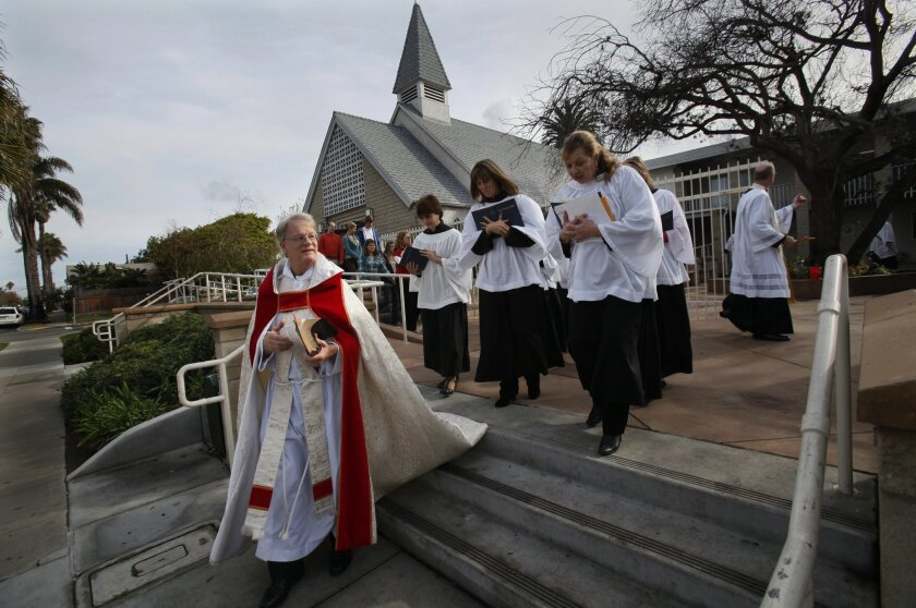 After Sunday's service, the Rev. Canon Lawrence Bausch led his congregation on a march from Holy Trinity Parish to what will be their new home a block away in Ocean Beach.
