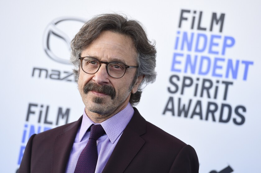 FILE - Marc Maron arrives at the 35th Film Independent Spirit Awards on Feb. 8, 2020, in Santa Monica, Calif. The podcast Maron started in his garage 12 years ago with producer Brendan McDonald will receive the Governors Award at the Podcast Academy's first-ever Ambies awards, which will stream Sunday, May 16, 2021, on YouTube and Twitch from Los Angeles. (Photo by Jordan Strauss/Invision/AP, File)