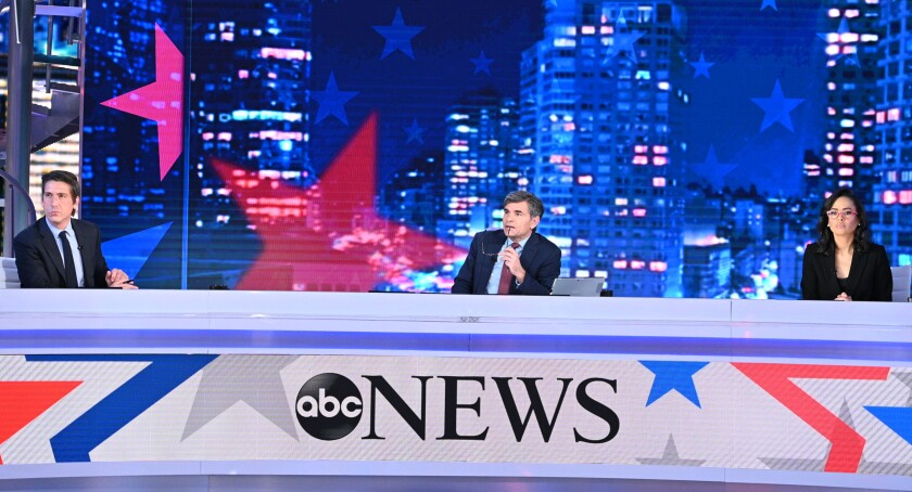 ABC's David Muir, left, George Stephanopoulos and Linsey Davis.