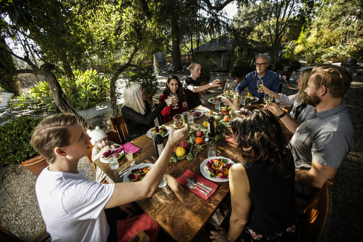 Andrea Crawford and her family partake in the holiday meal prepared at her home. The courses included rosemary steak skewers, radicchio salad, greens-stuffed flatbreads, kabocha squash and Meyer lemon tart.