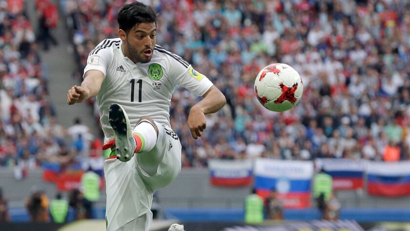 Mexico's Carlos Vela plays the ball during a Confederations Cup match against Russia on June 24.