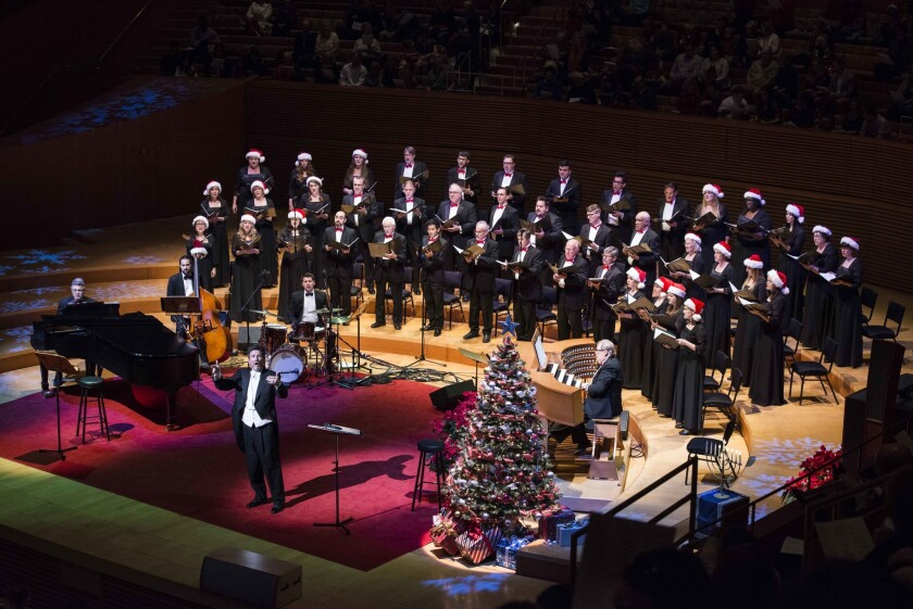 Conductor John Sutton leads Angeles Chorale in performance at Walt Disney Concert Hall.