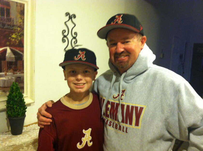 Randy Thompson and his son, Tyler, in 2014 when Tyler was fighing cancer.
