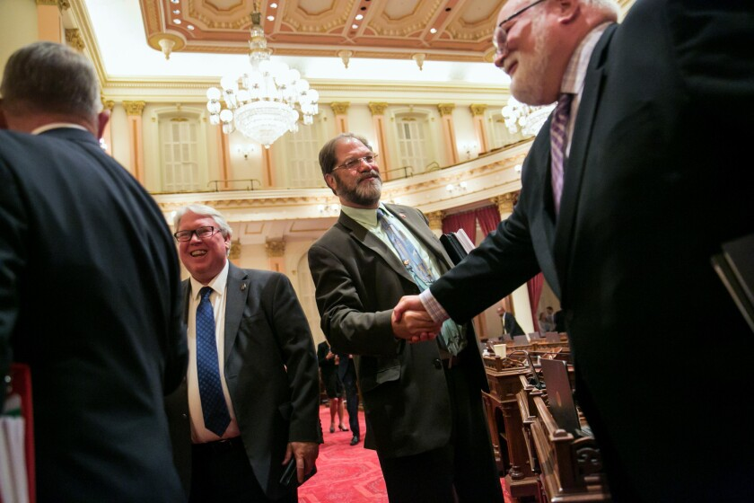 Sen. John Moorlach (R-Costa Mesa), second from right, bids farewell to fellow lawmakers at the end of the Senate floor session in Sacramento on Sept. 11, 2015. Moorlach is a leading voice in the Legislature against skyrocketing debt being piled up by public pension systems.