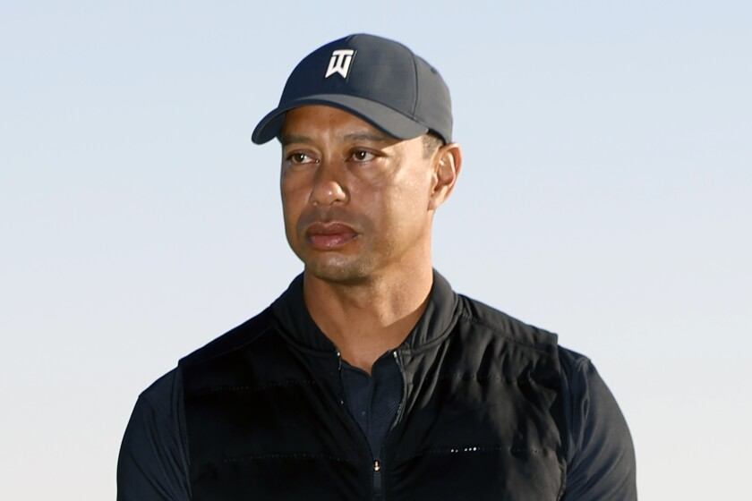 Tiger Woods looks on during the trophy ceremony at the Genesis Invitational golf tournament at Riviera Country Club
