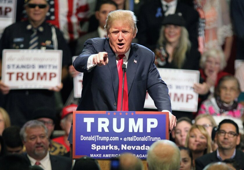 FILE - In this Oct. 29, 2015 file photo, Republican presidential candidate Donald Trump in Sparks, Nev. One year before Election Day 2016, Republicans are consumed by uncertainty and infighting while Democrats are coalescing behind Hillary Rodham Clinton. But there's a long way to go. (AP Photo/Lan