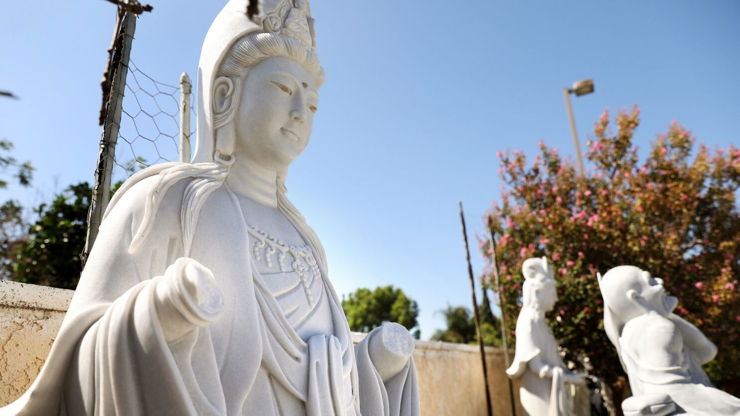Woman arrested after vandalism at O C  Buddhist temples