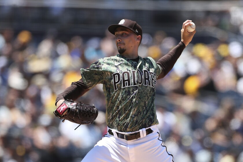 San Diego Padres starting pitcher Blake Snell delivers to an Arizona Diamondbacks batter in the first inning of a baseball game Sunday, Aug. 8, 2021, in San Diego. (AP Photo/Derrick Tuskan)