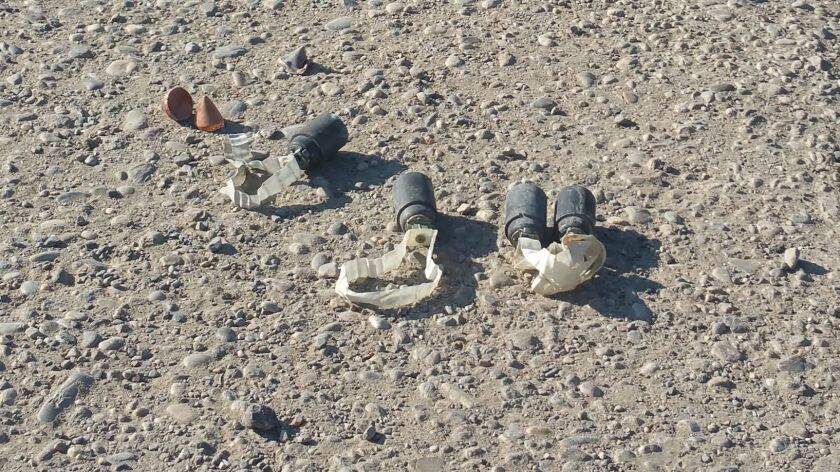 Unexploded cluster bomblets after an Islamic State attack on security forces near Mosul, Iraq.