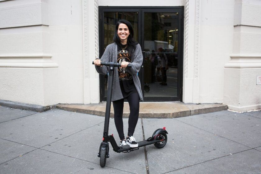 Jessica Rich on her e-scooter that she got as birthday present to help with her commute from Brooklyn to Manhattan during the L train shutdown.