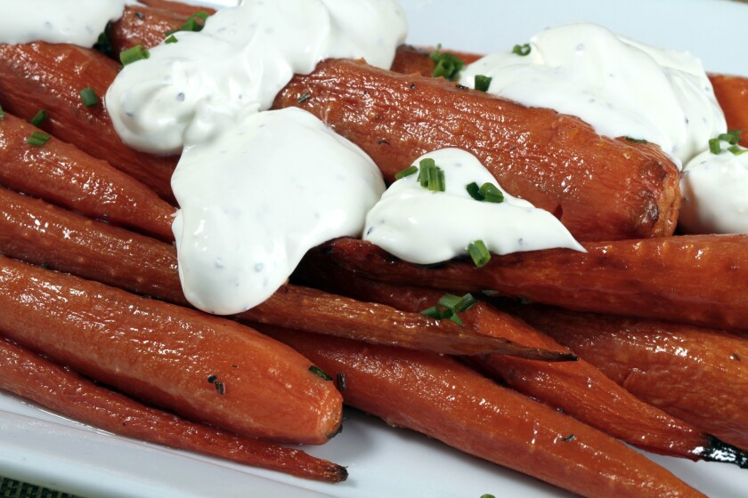 Connie and Ted's roasted carrots with rosemary butter and black pepper crème fraîche. Read the recipe »