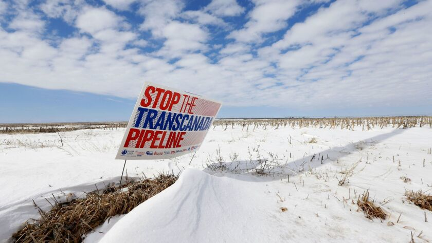 A pipeline protest sign in seen in a field near Bradshaw, Neb.