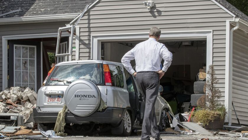 Massachusetts Gov. Charlie Baker tours the house on Chickering Road in Lawrence, where Leonel Rondon was killed Thursday in a gas explosion.