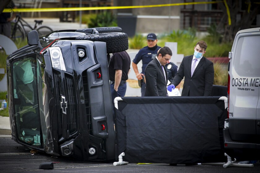 Police in Costa Mesa investigate the site where a person was killed early Thursday when a pickup overturned.