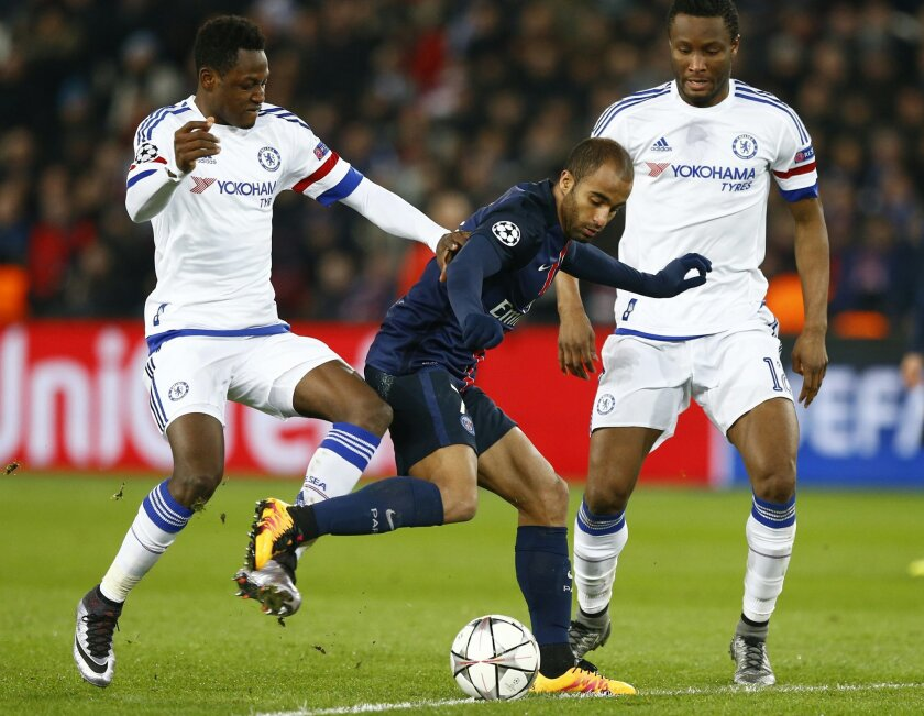 PSG's Lucas, centre is challenged for the ball by Chelsea's Baba Rahman, left and Chelsea's John Obi Mikel during the Champions League round of 16, first leg, soccer match between Paris Saint Germain and Chelsea at the Parc des Princes  stadium, in Paris, Tuesday, Feb. 16, 2016. (AP Photo/Francois
