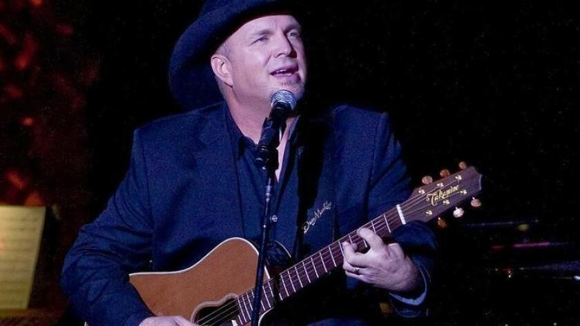 FILE - In this Nov. 17, 2014 file photo, Garth Brooks performs the 2014 ASCAP Centennial Awards, benefiting the ASCAP Foundation and its music education, talent development and humanitarian activities, at the Waldorf-Astoria in New York. (/ (Photo by Stephen Chernin/Invision/AP, File) The Associated Press)