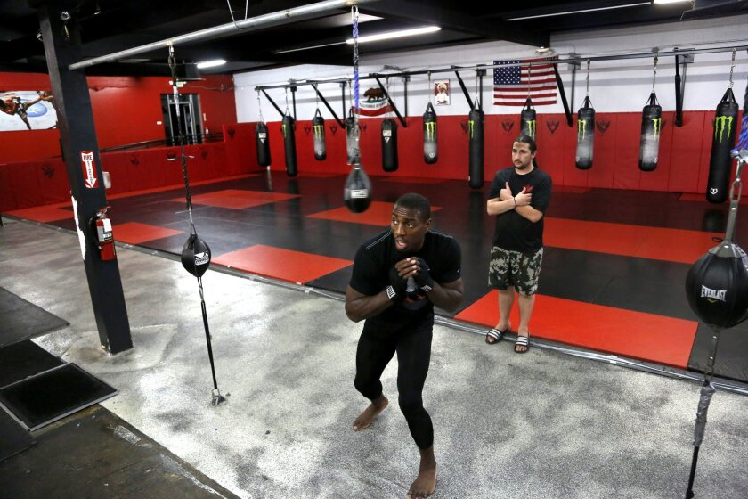 UFC light-heavyweight contender Phil Davis warms up under the supervision of Alliance MMA boxing coach Adrian Melendrez at Alliance Training Center. Davis will fight Vinny Magalhes at UFC 159 on April 27, 2003 at Prudential Center in Newark, New Jersey.