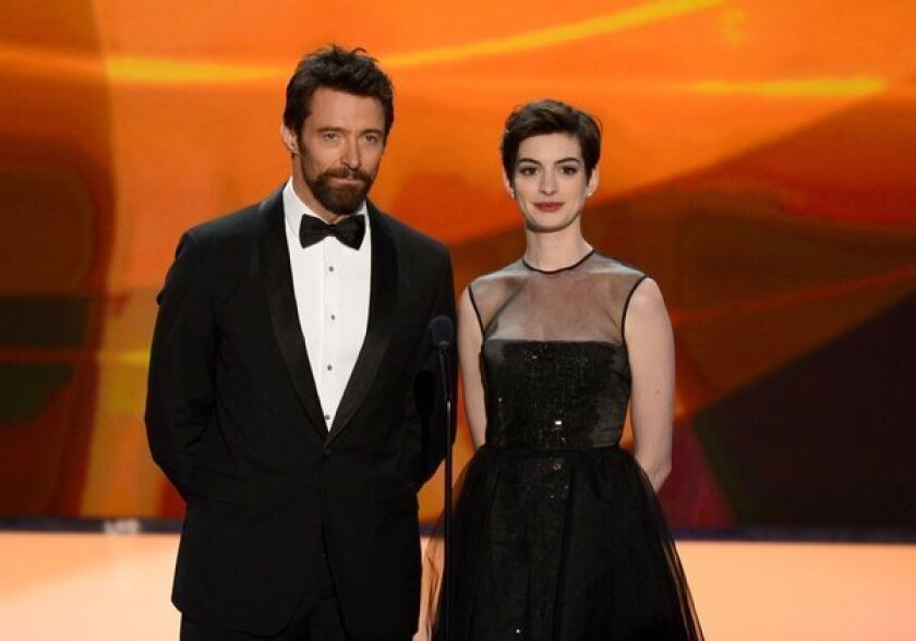 """Hugh Jackman and Anne Hathaway introduce """"Les Miserables"""" at the SAG Awards."""