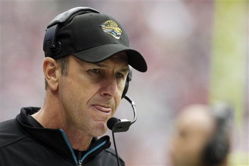 FILE - This Nov. 18, 2012 file photo shows Jacksonville Jaguars head coach Mike Mularkey watching action against the Houston Texans during the second quarter of an NFL football game in Houston. The Jaguars have fired Mularkey after one season, the worst in franchise history. New general manager David Caldwell made the announcement Thursday, Jan. 10, 2013. (AP Photo/Patric Schneider, File)