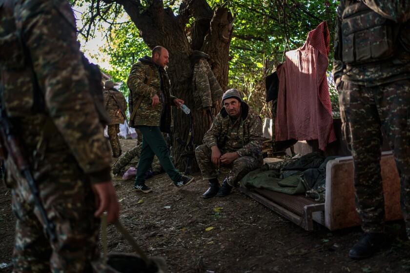 Soldiers shelter under trees to evade Azerbaijani drones near Hadrut, Nagorno-Karabakh.