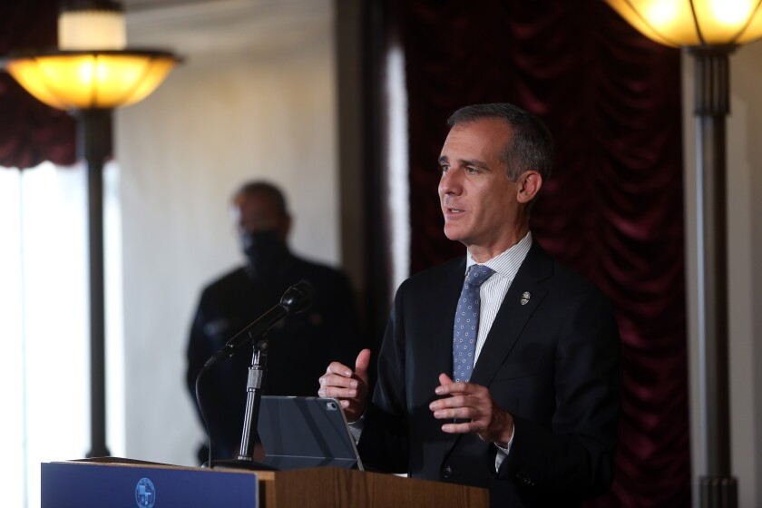 Los Angeles Mayor Eric Garcetti speaks during a news conference July 27.