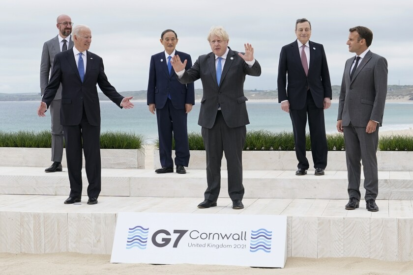 President Joe Biden and British Prime Minister Boris Johnson gesture as they pose for a family photo with G-7 leaders in Carbis Bay, England, Friday, June 11, 2021. Leaders from left, European Council President Charles Michel, Biden, Japan's Prime Minister Yoshihide Suga, Johnson, Italy's Prime Minister Mario Draghi and French President Emmanuel Macron. (AP Photo/Patrick Semansky, Pool)