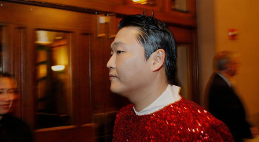 Obama attends Psy performance despite 'Dear American' flak